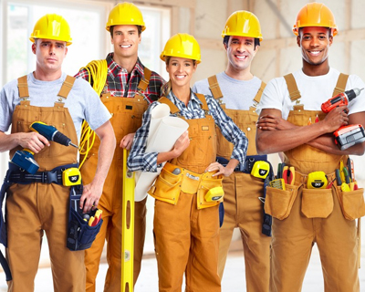 a group of workers holding tools